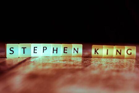 Stirling, Scotland - 15 August 2019: Stephen King word made of tiles on dark wooden background Banco de Imagens