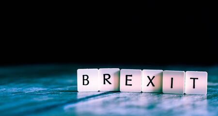 Brexit word made of tiles on dark wooden background Banco de Imagens