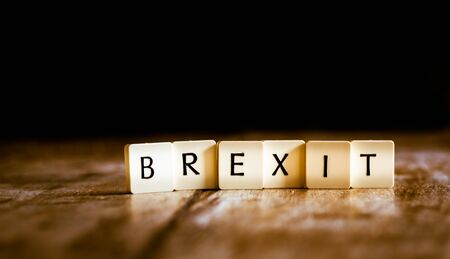 Brexit word made of tiles on dark wooden background Banco de Imagens - 130873994