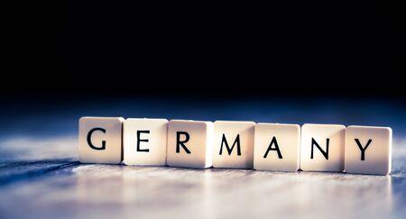 Germany word made of tiles on dark wooden background Banco de Imagens