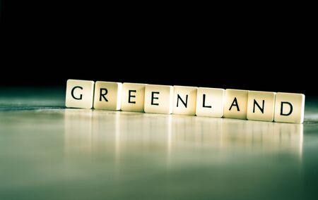 Greenland word made of tiles on dark wooden background Banco de Imagens