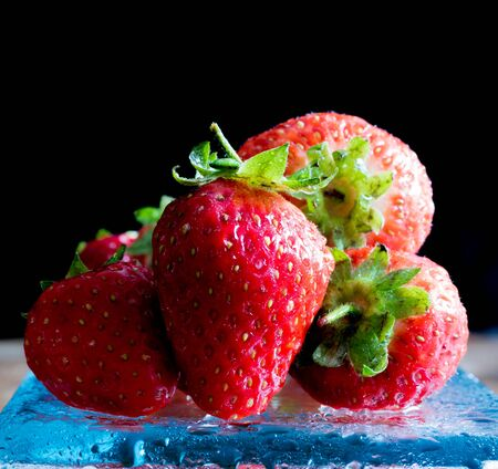 Fresh ripe red strawberries isolated on dark background Banco de Imagens - 130874105