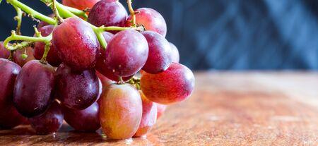 Fresh organic grapes isolated on vintage table Banco de Imagens