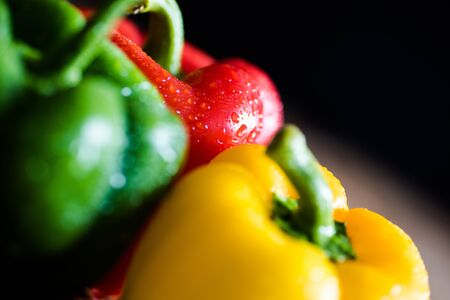 Close up of yellow, green and red capsicums Banco de Imagens