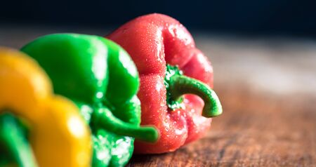 Curry ingredients - red, yellow and green capsicums