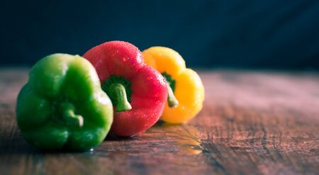 Expensive vegetables - red, yellow and green peppers (capsicums)
