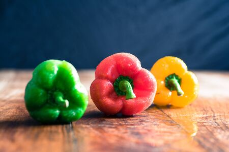 Exotic food - yellow, green and red capsicums Banco de Imagens