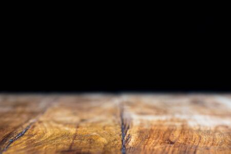 Grunge vintage table and black wall background
