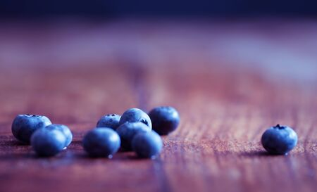 Close up on blueberries on wooden table