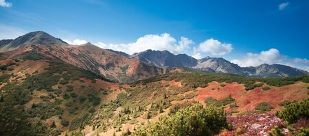Rocky summits of Tatra Mountains covered in autumn colours - hillwalking, mountaineering, sport, recreation