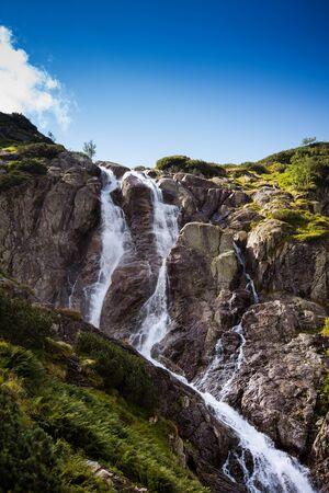 Siklawa waterfall near Zakopane in Tatra Mountains - sunny autumn day