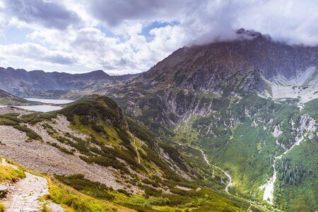 View on Przedni Staw, Wielki Staw and Kozi Wierch in clouds in Tatra Mountains Banco de Imagens