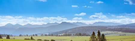 Panorama of Tatra Mountains in sunny summer day