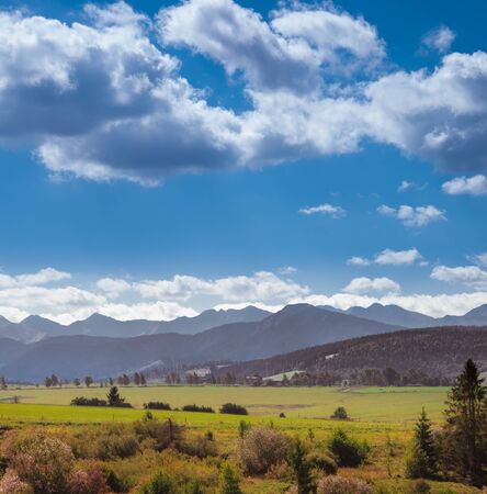 Panoramic View Of Field And Mountains Against Sky
