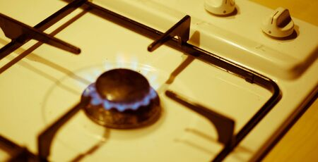 Old white cooker with blurred gas hob