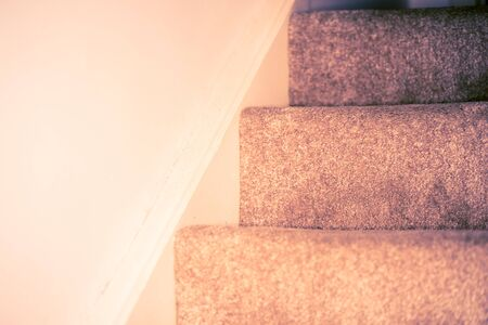 Staircase covered in dark grey carpet