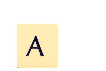 A tile with  capital letter A isolated on white background