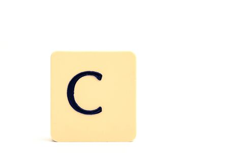 A tile with capital letter C isolated on white background