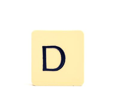 A tile with capital letter D isolated on white background