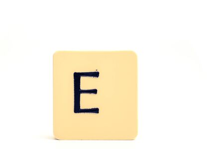 A tile with capital letter E isolated on white background