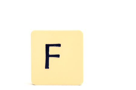 A tile with capital letter F isolated on white background Stockfoto