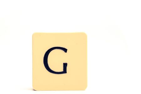 A tile with capital letter G isolated on white background Stockfoto