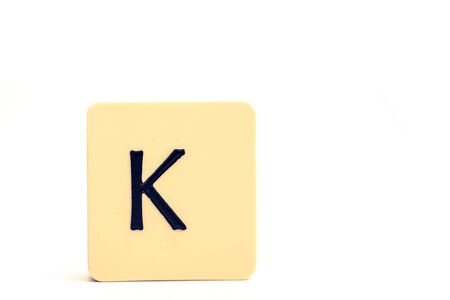 A tile with capital letter K isolated on white background