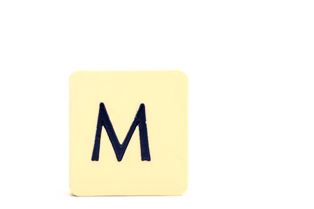 A tile with capital letter M isolated on white background