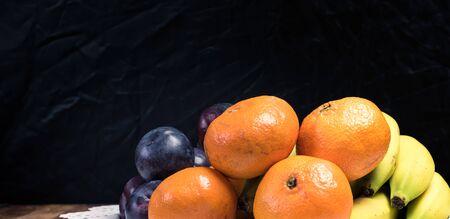 Fresh fruit selection against dark background