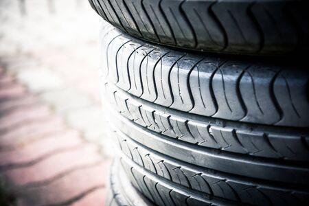 A pile used car tyres awaiting recycling