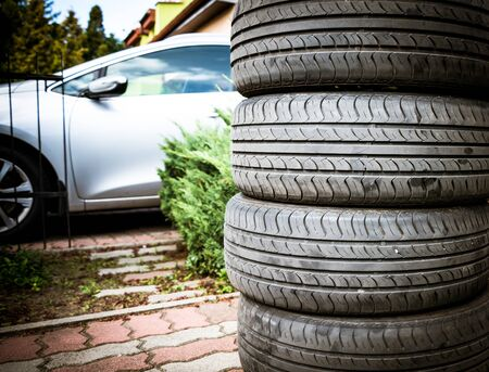 Tire stack background. Selective focus. Car in the background