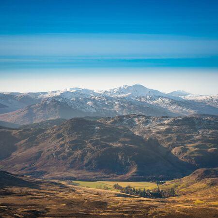 Scottish mountains winter landscape. Ben Vorlich, breathtaking munro, covered in snow.