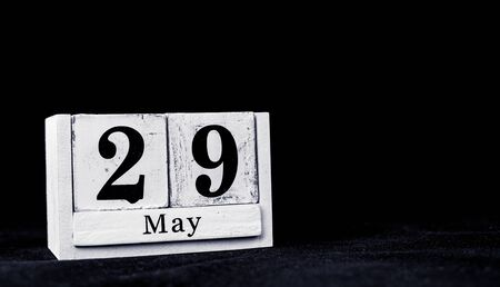 May 29th, Twenty-ninth of May, Day 29 of month May - vintage wooden white calendar blocks on black background with empty space for text Stock Photo