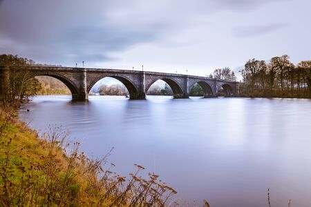 Dunkeld bridge over the river Tay in Perthshire, Scotland. Telford's famous bridge over the mighty River Tay, Dunkeld, Perth & Kinross, Scotland, Europe.