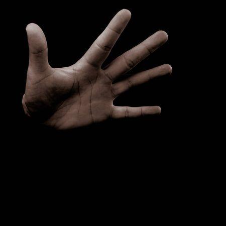 Open male hand on dark background Imagens