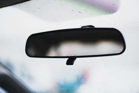 Rear view mirror close up in old car
