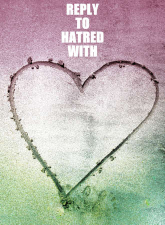 Reply to hatred with love phrase on a heart drawn in the sand on the Beach background