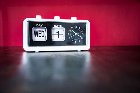 Wednesday 1st, First Wednesday of the month - white vintage alarm clock with set date and time