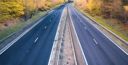 Empty dual motorway in UK - lockdown affects not only road traffic and transportation but also petrol prices