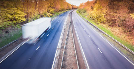 White truck on empty dual motorway in UK - drivers are key workers