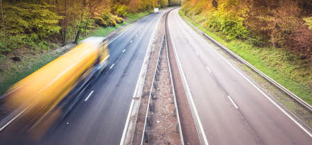Speeding blurred truck on a dual motorway in Scotland - speeding drivers of lorries are dangerous