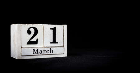 March 21st, Twenty-first of March, Day 21 of month March - white calendar blocks on black textured background with empty space for text