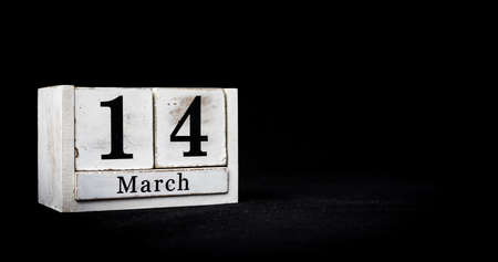 March 14th, Fourteenth of March, Day 14 of month March - white calendar blocks on black textured background with empty space for text