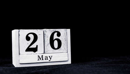 May 26th, Twenty-sixth of May, Day 26 of month May - vintage wooden white calendar blocks on black background with empty space for text