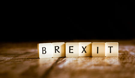 Brexit word made of tiles on dark wooden background 免版税图像