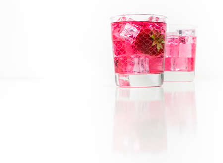 Strawberry vodka and lemonade in a galss isolated on white background
