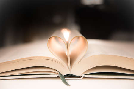 Heart from a book page against a dark background