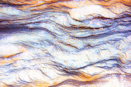 Rock layers - a colorful formations of sedimentary rocks stacked over the hundreds of years. Abstract background with fascinating texture for graphic design.