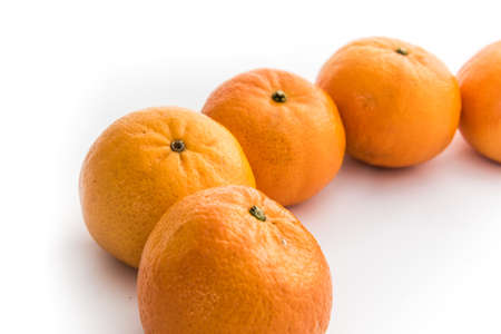 Ripe mandarines isolated on a white background