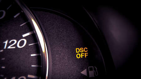 Close-up dashboard with DSC OFF warning light on